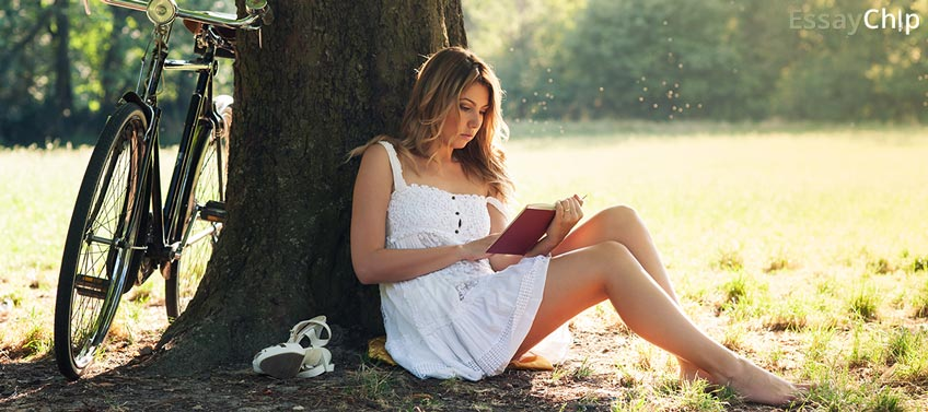 Girl Reading Book Under Tree